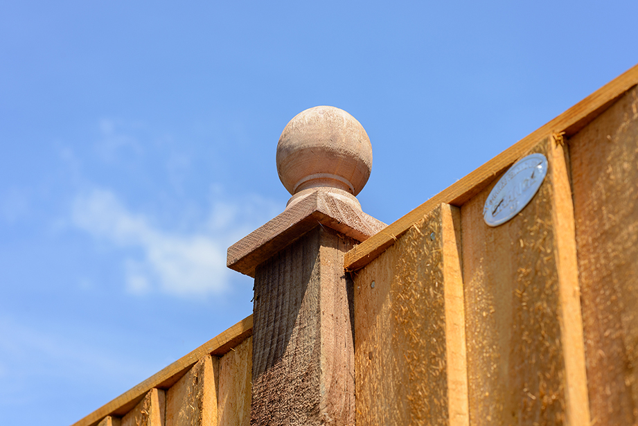 The Ball Finial Post Cap is a decorative way of finishing off fence panel posts. The design features a turned piece of timber that is pressure treated brown for protection against wood rot.