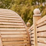 This Contemporary Arbour has real presence with modern straight lines, and a classic curved roof using quality finger joints. The arbour is pressure-treated to provide protection from wood rot and fungal decay.