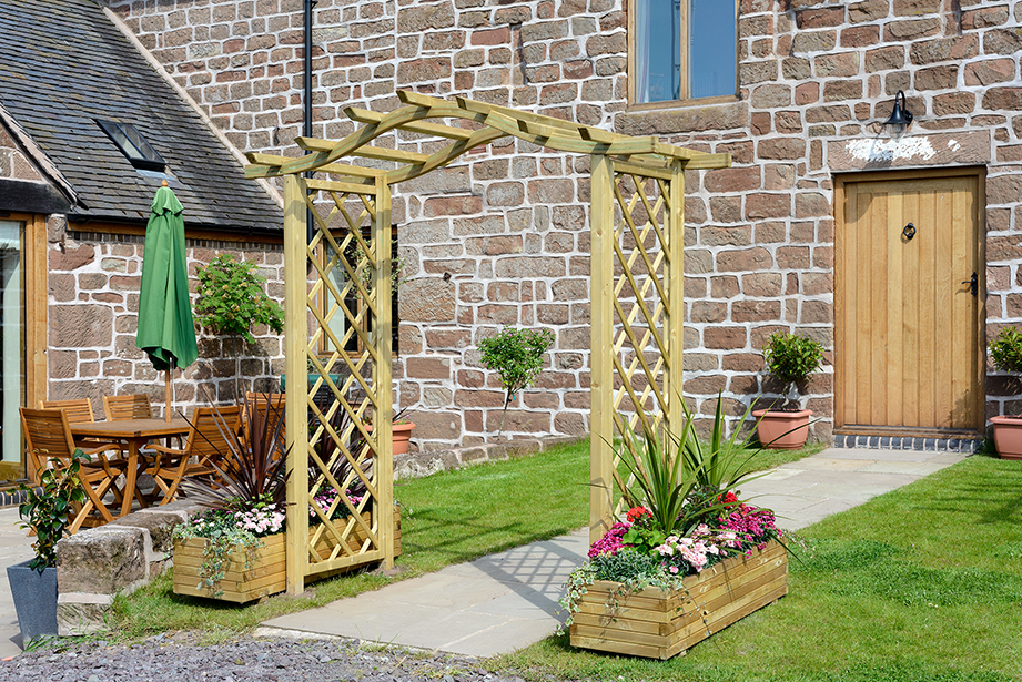 The Elite Portico Arch's unique design with a curved roof and lattice style trellis side panels offers a stylish solution for any garden space. The space for hanging baskets will enhance a path, or it can be used as a standalone feature. The pressure treated finish provides ultimate durability.