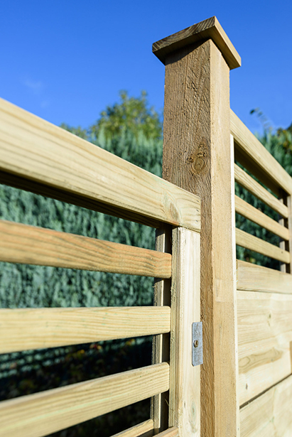 Featuring straight cut slats and a horizontal-style trellis top, the Elite Lille panel from Grange Fencing has been pressure-treated for long-lasting use.