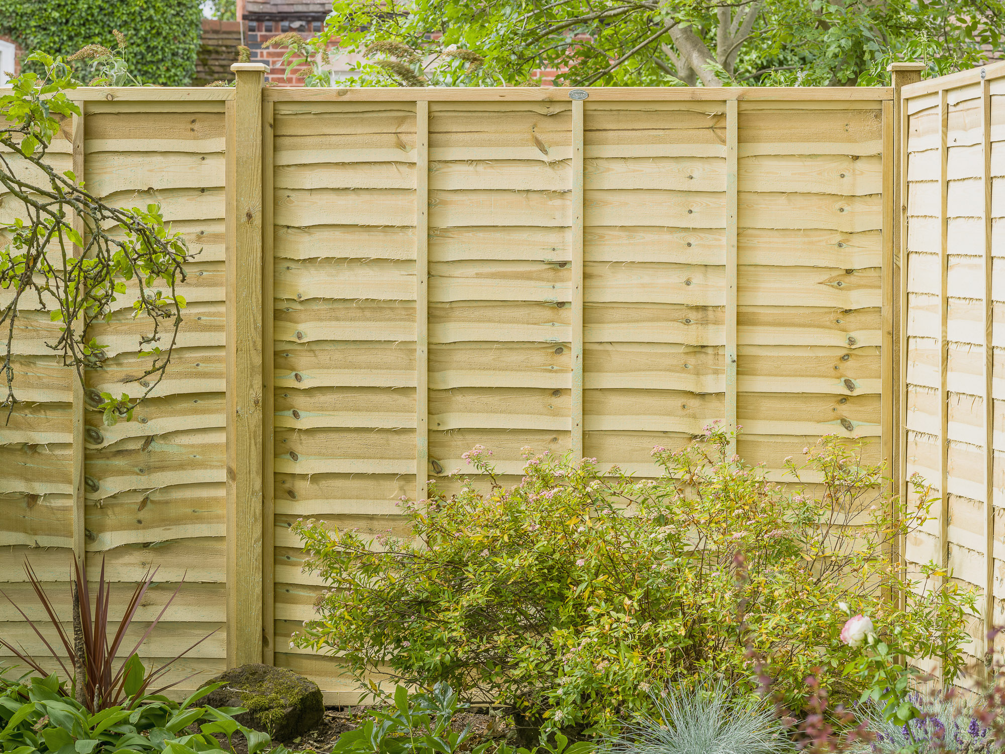 PROFESSIONAL LAP FENCE PANEL A stronger lap panel with three battens and new rebated frame construction. Available in a choice of three colours, pressure-treated golden brown, pressure-treated green or dark brown for protection against wood rot and fungal decay.
