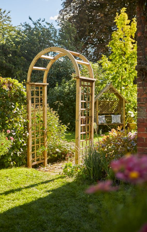 The Elite Granville Arch has a classical look as well as being strong and robust. This arch is suitable as a freestanding structure on either a path or garden space. The square trellis sides are ideal for climbing plants. Made from pressure treated timber and finished in pale green for longevity in use.