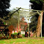 This Rustic Rose Pergola is made from machine rounded pressure-treated timber, creating a truly natural garden structure. An ideal pergola for a traditional setting and adding character to any outdoor space.