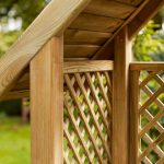 This classic arbour is designed with diamond trellis sides and back to support climbing plants. The slatted roof provides extra protection from the sun, and the sturdy yet comfortable bench enables you to sit back and relax. It is made from pressure-treated timber for long lasting protection.