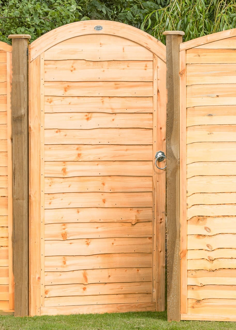 The Grange Side Entry Arched Lap Gate is a great addition to the range and is a great addition to a run of Grange Lap Fencing. The side entry arched lap gate is made from pressure-treated timber ensuring longevity in use.